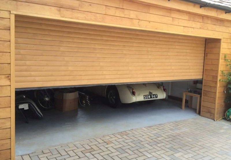 Wood roll up garage doors